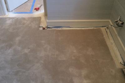 Installation of custom cut silk rug